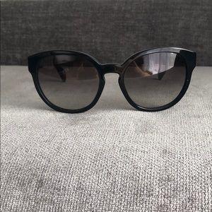 Large oversized black Prada sunglasses
